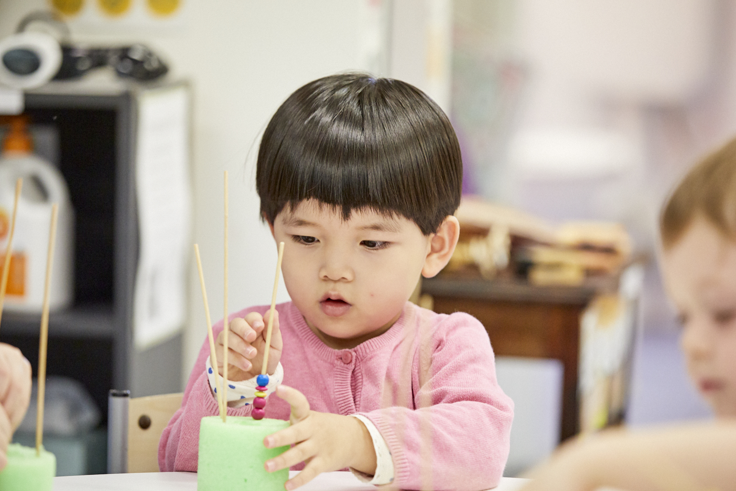 Young child in child care classroom at Papilio Ryde