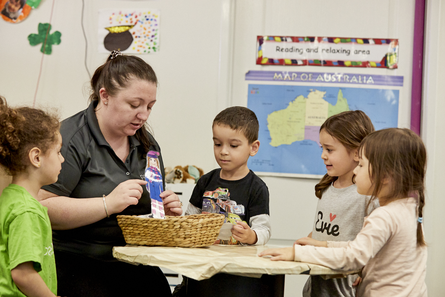 Child care educator with group of young children in child care classroom at Papilio Ryde
